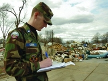 (Then) C/Maj Grant Godar of Springfield Composite Squadron in Springfield, IL performs damage assessment in Springfield following tornadoes in 2006